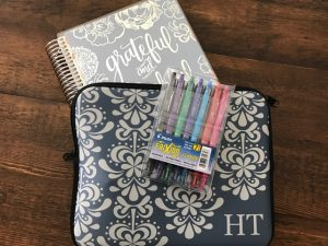 Erin Condren planner, carry case, and Frixion pens.